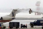 Reuters photo of de-icing of a American Eagle commuter jet at Ronald Reagan Washington National Airport